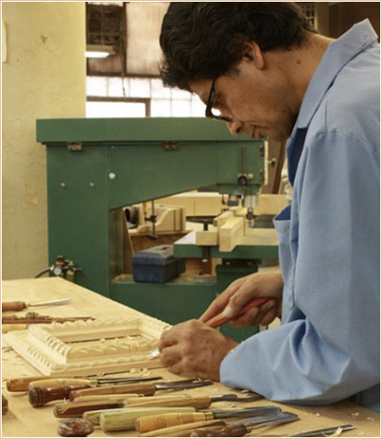 A skilled craftsman working on a replica frame