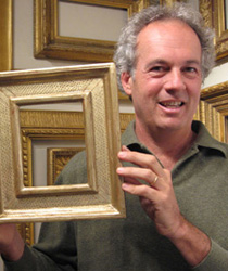 Eli Wilner holding a period reproduction frame