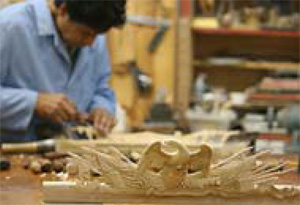 Master woodcarver, Félix Terán with the test carving of the frame's elaborate eagle crest