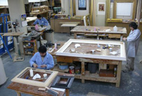 Various experts working in the frame restoration studio
